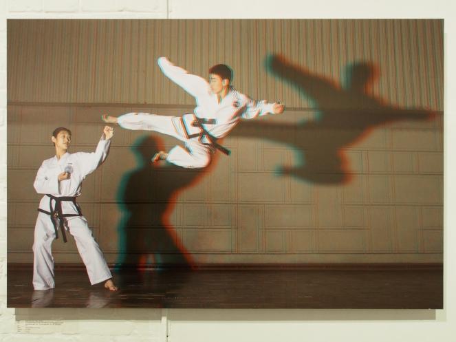 PAK MI HYANG, 20, 1st Dan + RA KYONG HUN, 22, 2nd Dan, Taekwondo Stadium.