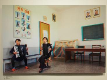 Kang Hyon A. 13 years. Student. Myong Ju 38 years Accordion Teacher Kaesong Schoolchildrens Palace.