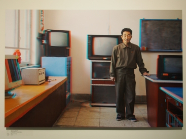 LI WON SIK, 49, Teacher, Electronics Club Classroom, Kaesong Schoolchildren's Palace.