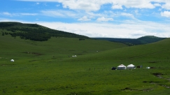 Occasional mongol yurts scattered along the hill side.