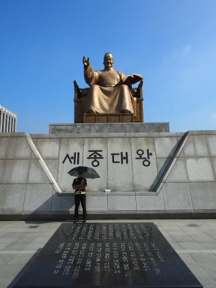 Gwanghwamun Square, a 555m long, 34 m wide plaza in front of Gwanghwamun, the main gate of Gyeongbokgung palace. Statues of Admial Yi Sunshin and King Sejong, two of the most respected historical figures in Korea are watching over visitors.