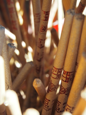 Sticks of burned out incense on front of Guan Di Temple.