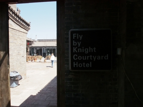 The entrance to the Fly By Knight Hotel, right off one of the busy main streets of the city.