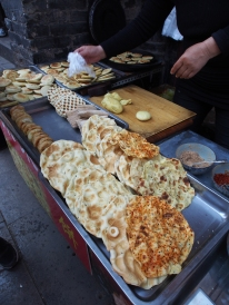 Hunting for some snacks in Pingyao.