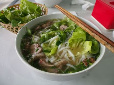 For breakfast the one of the traditional local dishes is Pho, a form of noodle soup with fresh salad, meat slices and lime juice.